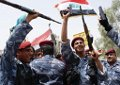 Iraqi police celebrate withdrawal of US troops from Basra on June 30 2009