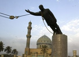 iraqis aided by US marine topple a huge statue of Saddam in main square in Baghdad