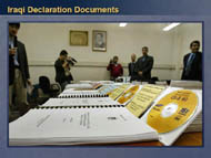 slide 10 photo of iraqi documents laid out on a table